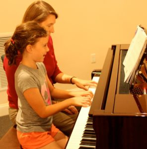 Teacher-Student Duet: Play piano